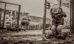 Splash.. (alex_butler_photography) Tags: puddle jumping splash child boy fun mischief bw