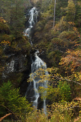 Autumnal waterfall (JennPorteous) Tags: scotland waterfall water longexposure highlands autumn seasons uk green trees orange invergarry alltnacaillichetrail