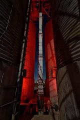 silos. calipatria, ca. 2016. (eyetwist) Tags: eyetwistkevinballuff eyetwist silo silos lift grain abandoned farm agriculture calipatria saltonsea night desert dark nikon nikond7000 d7000 nikkor capturenx2 1024mmf3545g 1024mm fullmoon photography gel tripod npy nocturne longexposure derelict lightpainting red flashlight ruin decay california imperial sonorandesert salton sea startrails american west ca111 imperialvalley niland farming alfalfa tank tower old girder hardware truss steel landscape building tall corrugated storage lookup shadows ladder urbex industry industrial