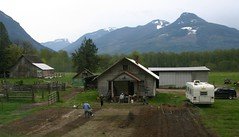 IMG_7094 - Skagit Valley - Hwy 20 - spring gardening (BlackShoe1) Tags: family people house mountain mountains car kids fence garden children parents washington kid spring farmers farm shed ground dirt parent wash sprinkler pacificnorthwest wa plow washingtonstate camper plowing 2009 planting watering skagitvalley topten outbuilding outbuildings rototilling framehouse highway20 cascadesmountains wa20