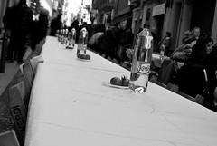 Poniendo la mesa - Set the  table (Explore) (i.puebla) Tags: barcelona street city blackandwhite bw espaa byn blancoynegro blackwhite calle spain nikon chairs bottles bokeh ciudad catalonia tables callejeando catalua mesas streetview gracia sillas d60 airelibre botellas monocromtico barriodegrcia comidaspopulares popularlunches