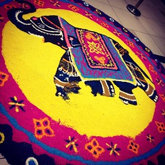 Rangoli, also known as Kolam or Muggu, is a folk art from India in which patterns are created on the floor using materials such as colored rice, dry flour, colored sand or flower petals. Came across this rangoli at the mall during Diwali. (MagDev) Tags: elephant colourful diwali petalingjaya kolam rangoli tropicanacitymall
