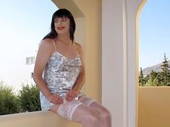Stocking show (Paula Satijn) Tags: sexy hot girl gurl tgirl satin silk shiny nightie chemise dress greece sunny smile stockingtops balcony outside legs stockings happy beauty summer