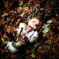 Doll in a Bed of Wet Leaves, N. Michigan Alley (Robert_Brown [bracketed]) Tags: autumn fall wet leaves oregon trash mississippi square portland toy alley doll michigan north lofi squareformat avenue robertbrown iphoneography instagramapp uploaded:by=instagram