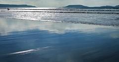 Lone Surfer... (DawnWarrior) Tags: gower sea seaside seascape surf surfer surfing reflection autumn sunshine llangenith wormshead rhossili beach sonyrx10 dawnwarrior hdr