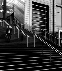 Keeping in Line (TS446Photo) Tags: nikon nikkor london d600 zeiss black white bw blackandwhite mono monochrome noiretblanc noir blanc lines architecture building shopping stairs rails person woman street girl walk down up chrome metal dslr camera city streetlife life londonfineartphotography fineart print photo photography
