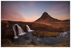 Kirkjufell, Iceland (Ashley Lowry) Tags: iceland ice iconic ico multicoloured morning mountains moun dawn daybreak day firstlight sunrise sunup gold grass glow atlantic blue b clouds colour green horizon horizonoverwater holiday island icelandic kirkjufell church snaefellsnes snæfellsnes peninsula light landscape lights longexposure leaves nature naturallight outdoor outdoors outside november pink pretty purple rocks sky view viewing water white wet yellow river waterfalls waterfall fall flow kirkjufellfoss