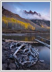 Sievers Mountain (adam_pierz) Tags: marroonlake maroonbells sieversmountain colorado autumn aspens lake trees logs dawn sunrise nikond600