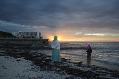 Watchers (Cosmic Oxter) Tags: sunset seapoint seapointpromenade seascape balance colours purple lime orange muslim women locals evening beach southafrica western cape 35mm
