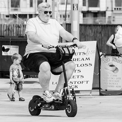 Scooter Man... (Mel Low) Tags: mono blackandwhite candid streetscene scooter square outdoor nikond7000