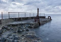 Sea work (halmrast photo) Tags: norway runde vestlandet sea ocean coast westcoast landscape quay brew rust stone concret
