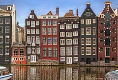 "The ""Dancing Houses"" at the Damrak, Amsterdam (PhotosToArtByMike) Tags: amsterdam damrak centrum dancinghouses centercity netherlands canalhouses damrakcanal architecture amsterdamcentraal dutch holland crookedhouses"