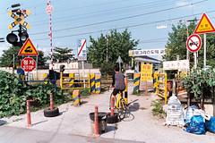 Biker on the railway (Wanna be Henry) Tags: bicycle nikon railway f3 proimage100 wonju