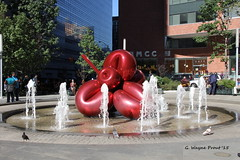 Balloon Flower (Red) by Jeff Koons (Gerald (Wayne) Prout) Tags: world newyorkcity sculpture usa newyork fountain canon manhattan clinton greenwich 911 center trade batteryparkcity jeffkoons survivors prout greenwichstreet 7worldtradecenter balloonflowerred stainlesssteelsculpture canoneos60d geraldwayneprout