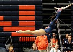 Uneven bars (RPahre) Tags: illinois gymnastics universityofillinois champaign huf orangeandblue unevenparallelbars huffhall sunnykato