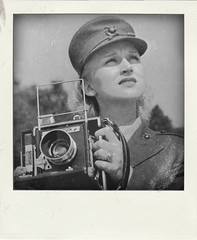 Camera Girl - Private Eleanor R Marschke in training (Leo Reynolds) Tags: xleol30x poladroid polaroid faux fauxpolaroid fake fakepolaroid phoney phoneypolaroid bw people nottakenbyme camera photographer