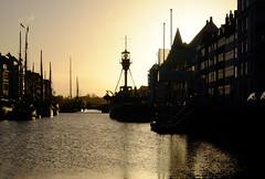 Silhouettes at Nyhavn in Copenhagen, Denmark (` Toshio ') Tags: toshio copenhagen denmark danish nyhavn lightship masts ships harbor sunrise water europe european europeanunion fujixe2 xe2