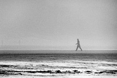 In The Mist (kernowrules) Tags: bw mist beach person mono sand walker kernowrules