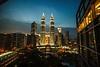 Moon & Towers (nikolombardo) Tags: moon twilight malaysia kualalumpur petronastowers tradershotel