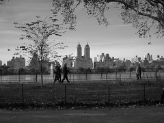 Central Park West skyline + people (amysh) Tags: nyc newyorkcity bw newyork centralpark candids jacquelinekennedyonassisreservoir eastdrive olympuse420