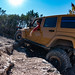 Gold Jeep on a Trail