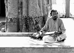Baul Singer (Veena Nair Photography) Tags: travel india shot candid singer kolkata westbengal ektara santiniketan baulsinger mysticsinger baulsingershantiniketan