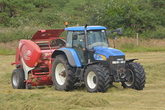 New Holland TM190 Tractor with a Lely Welger 245 XtraCut Round Baler (Shane Casey CK25) Tags: new holland tm190 tractor lely welger 245 xtracut round baler nh cnh blue watergrasshill newholland silage silage16 silage2016 grass grass16 grass2016 winter feed fodder county cork ireland irish farm farmer farming agri agriculture contractor field ground soil earth cows cattle work working horse power horsepower hp pull pulling cut cutting crop lifting machine machinery nikon d7100 traktori tracteur traktor trekker trator cignik hay