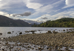 Loch Ness (Kev Gregory (General)) Tags: early morning looking across loch ness from west a82 north fort augustus scottish highlands kev gregory canon 7d shore shoreline stones pebbles waters edge blue sky clouds lake