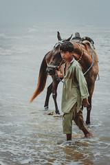 Need A Ride! (arun kumar photography) Tags: blue ride rider horse child human waves ocean french beach karachi pakistan sindh atarvr canon 50mm 600d