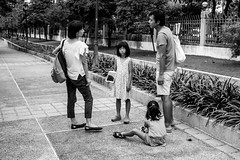 Joy and excitement of the Sunday afternoon family escapades (Tricycl) Tags: thailand benjakiti park bangkok family sunday divorce bored girl children black white noiretblanc urban city people ricoh gr ii