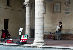 """"""" Pienza ... a busker, layering of stories. """" (pigianca) Tags: italy pienza busker music architecture streetphoto urbanphoto leicaq"""