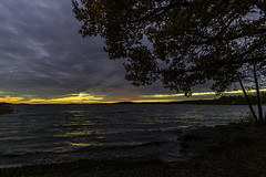 The last light of the day (kaffealskare) Tags: sunset solnedgng serene skies himmel moln clouds outdoor seaside water vatten lake sj landscape tree