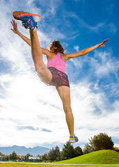 Landing on the runway (Flickr_Rick) Tags: outside autumn bluesky woman brunette athletic beautiful strong jamie jump jumping jumpology