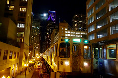 Green Line train under a SuperMoon (KevinIrvineChi) Tags: sony dscrx100 cta green line loop chicago chicagoist chicagotransit chicagotransitauthority elevatedtrain elevated l amber yellow purple skyscrapers sky moon supermoon blue night outdoors outside outdoor downtown urban curbedchicago buildings architecture moving movingtrains lights evening parking garage tracks railroad public transport transit transportation train trains railcar rapid rail vanishing point