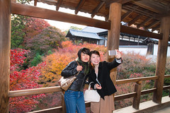 Two women taking selfie picture in Japanese fall foliage (Apricot Cafe) Tags: canonef2470mmf28liiusm img7586 asianethnicity japan japaneseethnicity autumn autumnleaves beautyinnature bridge change charming cheerful colors enjoying foliage freshness happiness hope japanesefallfoliage japanesemaple leaves mapleleaf nature onlywomen outdoors people refreshing selectivefocus selfie smartphone takingpictures toothysmile tranquility traveldestinations twopeople walking woman youngadult