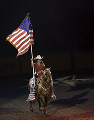 024693621-83-2016 NFR Stars and Stripes-1 (Jim There's things half in shadow and in light) Tags: 2016 canon5dmarkiv canon70200lens nfr nationalfinals nevada rodeo southwest thomasandmack unlv action cowboy december sports cowgirl americanflag horse