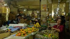 selling fruits (grapfapan) Tags: street bali woman indonesia market candid bazar singaraja