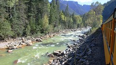 View of the Animas River from the train on September 17, 2015 (lhboudreau) Tags: railroad trees mountain mountains tree train river rockies colorado silverton rail trains pines locomotive rockymountains steamer pinetrees steamengine locomotives sanjuanmountains narrowgauge animas dsngr steamlocomotive steamengines animasriver steamlocomotives durangoandsilverton silvertoncolorado sanjuannationalforest narrowgaugerailroad durangoandsilvertonnarrowgaugerailroad