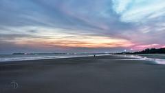 (Divs Sejpal) Tags: ocean pink blue sea sky india man color beach water clouds landscape one alone colours formation single arabian outrage diu divyesh divssejpal sejpal skescape