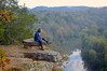 Ponder (Pic 2, Light Edit 2) (imkaifilbey) Tags: morning trees sky orange mountains green fall water leaves rain yellow fog clouds sunrise reflections river hair early rocks sitting boots hiking seat coat foggy lookout hike steam hills marmot merrell harpeth
