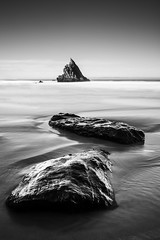 The rocks in your path will lead you there (Hugo Carvoeira) Tags: praia adraga portugal beach black white long exposure lee big stopper water ocean waves rocks