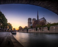 Paris - Notre Dame (nicolaspika) Tags: france olympus landscape sunset notredamedeparis city barge landscapephotography seine trees dock paris river architecture automn notredame cathedral photosergereview ledefrance fr