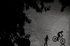 Stoppie... (_MaK_) Tags: street shadow cycle stoppie monochrome stunt kid tree people bw reverse candid bangladesh minimalism