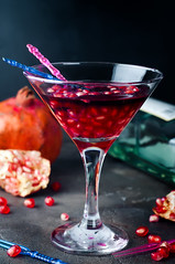 Pomegranate martini with pomegranate seeds in a glass (lyule4ik) Tags: cocktail drink pomegranate juice holiday xmas party background fruit summer leaf alcohol refreshment liqueur glass sweet red beverage fresh black gin cold condensation grenadine bar vodka copyspace refreshing tasty caribbean crushed reflection rum alcoholic vacation isolated slice berry delicious tropical cube hurricane studio ice dark long dew closeup ripe