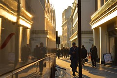 Strand 1dec16 (richardbw9) Tags: london uk england westminster city street urban londonstreetphotography sunset shadows shadow shadowplay intothesun gold orange coach reflection coutts dodgybanker bank charingcross manonphone phonezombie
