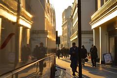 Strand 1dec16 (richardbw9) Tags: london uk england westminster city street urban londonstreetphotography sunset shadows shadow shadowplay intothesun gold orange coach reflection coutts dodgybanker bank charingcross manonphone phonezombie
