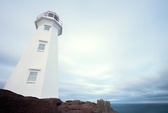 Under the Lighthouse (Karen_Chappell) Tags: lighthouse capespear canonefs1022mm wideangle nd110 longexposure blue white canada atlanticcanada atlantic architecture newfoundland nfld avalonpeninsula pastel