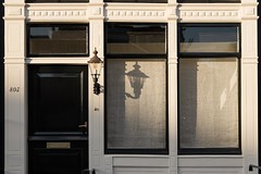 Light and shadow (Paola Salvanelli) Tags: amsterdam olanda sunset window lights ombre simmetrie arquitecture dettagli details netherlands house white wodden