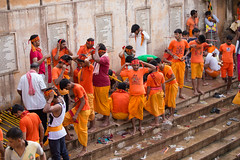 kawadias busy in preparations (durgeshnandini) Tags: street orange india men photography hinduism jaipur saffron holywater hindus shivji galtaji shrawanmonth kawadia kawadyatra