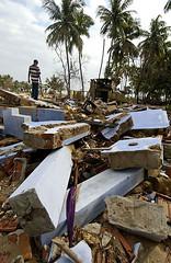Inspecting a damaged home in Komari, Sri Lanka